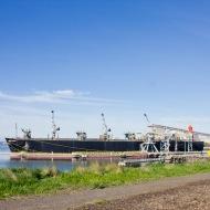 Ship loading bulk wood chips